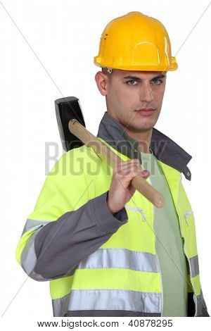 Labourer carrying a mallet