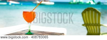 Orange Cocktail In Glass On The Beach Club At The Seaside. Summer Vocation. Web Banner