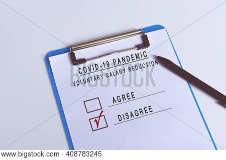 Checklist Attached On Blue Clip Board And Pen - Disagree Of Voluntary Salary Reduction