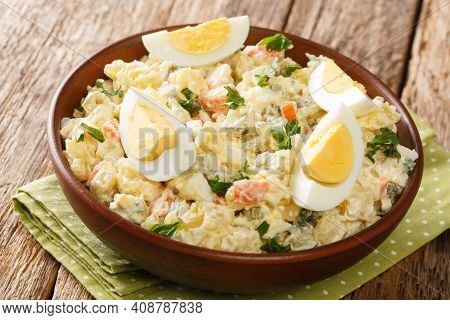 Rustic Style Estonian Potato Salad With Cream Dressing Close-up In A Bowl On The Table. Horizontal