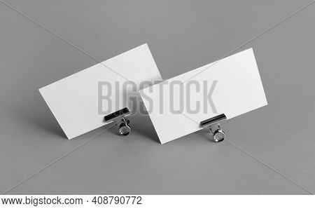 Blank Business Cards. Photo Of Blank White Business Cards On Gray Paper Background. Mockup For Brand