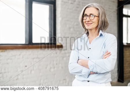 Confident And Smiling Old Senior Business Woman Wearing Smart Casual Shirt And Stylish Eyeglasses St