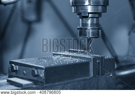 The Nc Milling Machine Drilling  At The Metal Part By Flat Drill Tools. The Shop Floor Operation By
