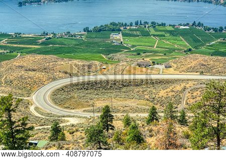 C-shape Road In Okanagan Valley On Summer Day