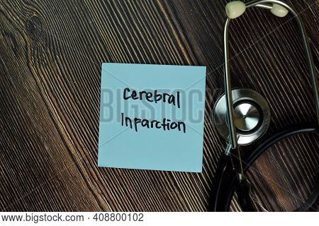 Cerebral Infarction Write On Sticky Notes Isolated On Wooden Table. Medical Or Healthcare Concept