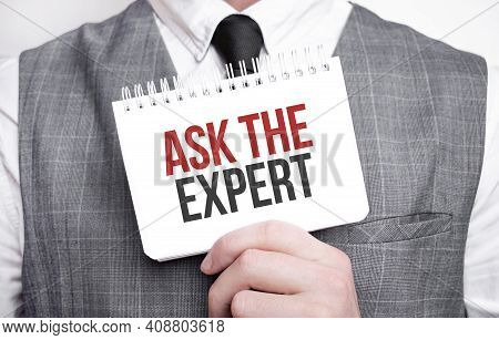 Businessman With Notebook With Text Ask The Expert