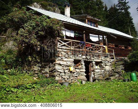 Alpine Hut And Alpine Farming On A Mountain Pasture