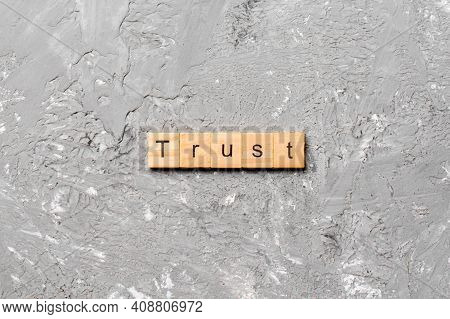 Trust Word Written On Wood Block. Trust Text On Table, Concept.
