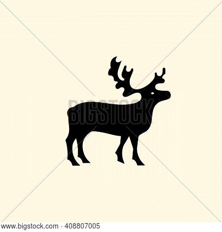 Reindeer Logo With Branched Antlers. Logo. Emblem Or Symbol. Vector Illustration. Flat Design.