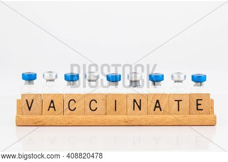 Get vaccinated concept in white background. Vaccinate word in english