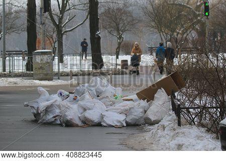 Kyiv Ukraine - February 03 2021: Environmental Pollution. A Dump On The Sidewalk Near A Pedestrian C