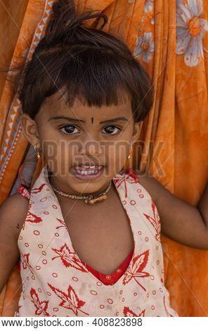 Anegundi, Karnataka, India - November 9, 2013: Lepakshi Handicrafts Non-profit. Portrait Of Litte Gi