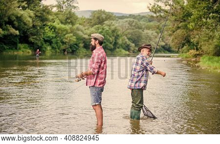 Get Hobby. Hobby And Sport Activity. Trout Bait. Male Friendship. Family Bonding. Two Happy Fisherma