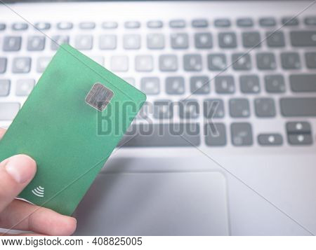 People Hands Holding A Credit Card And Using Computer Keyboard For Online Shopping