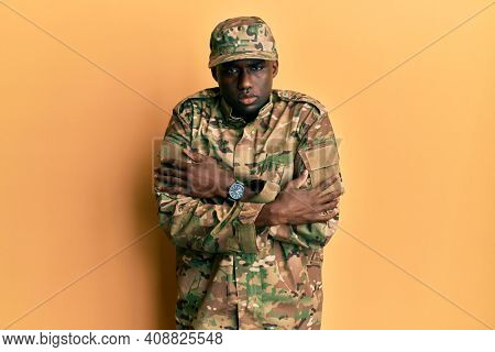 Young african american man wearing army uniform shaking and freezing for winter cold with sad and shock expression on face