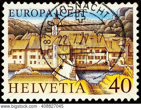 Moscow, Russia - February 17, 2021: Stamp Printed In Switzerland Shows Saint-ursanne, Old Town In Ca