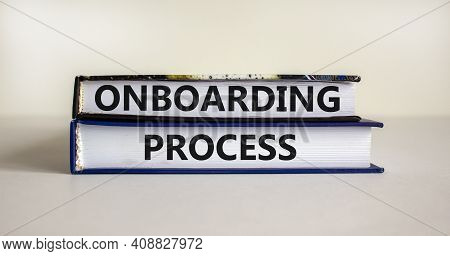 Onboarding Process Symbol. Books With Words 'onboarding Process' On Beautiful White Background. Busi