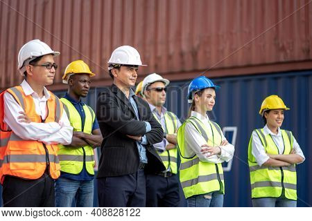 Engineer And Foreman Control Loading Container At Commercial Dock Cargo Freight Shipping, Teamwork I