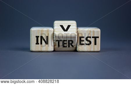 Invest Or Interest Symbol. Turned A Wooden Cube And Changed The Word 'invest' To 'interest'. Beautif