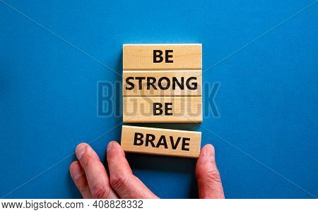 Be Strong Be Brave Symbol. Wooden Blocks With Words 'be Strong Be Brave'. Beautiful Blue Background.