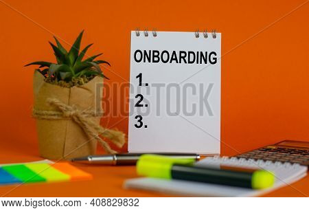 Onboarding Symbol. White Note With A Word 'onboarding' On Beautiful Orange Background, Colored Paper