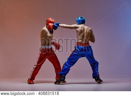 Sparring Of Fighting Athletic Males Boxers Wearing Boxing Gloves During Battle, Martial Arts, Mixed