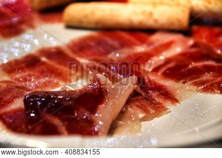 Tasty Iberian Ham Dish In A Bar In Spain. Typical Spanish Tapa.
