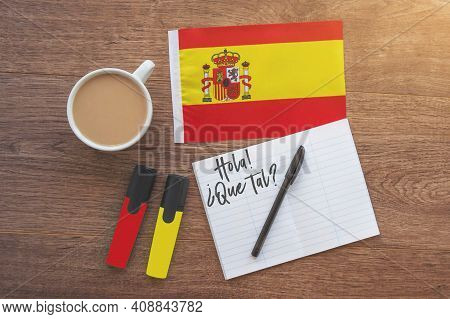 Spain National Flag, Notebook With The Inscription Hello, How Are You In Spanish, Two Markers, Cup O