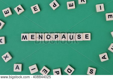 Top View Of Square Letters With Text Menopause.