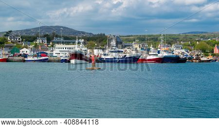 View Of Harbour And Otwn Of Castletown Bere In The South Of Ireland And The Mountains At The Backgro