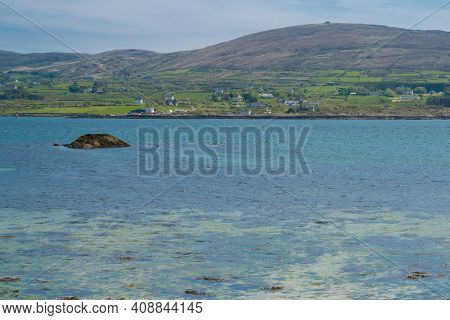 View Over Water From Castletown Bere To Bere Island In The South Of Ireland And The Mountains At The