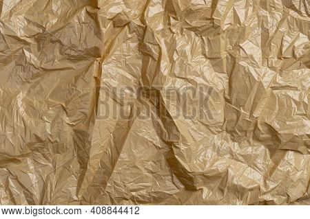 Textured Crumpled Wrinkled Garbage Plastic Bag. Brown Abstract Background