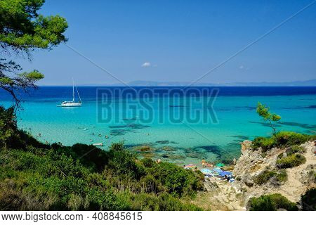 Chalkidiki,  Greece - August 14, 2017 : Paradisiac  Beach With Turquoise Waters In Chalkidiki Greece