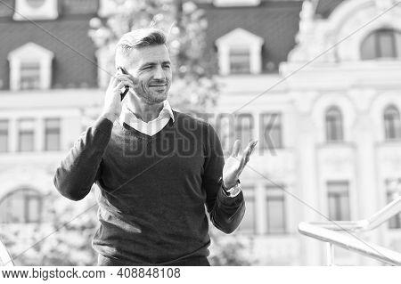 Are You Ok To Talk. Happy Man Talk On Phone Urban Outdoor. Talk Business. Sales Talk. Telephone Surv