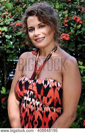 Outdoor Portrait Of A Beautiful Mature Woman In The Garden