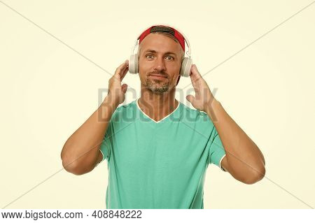 Some Good Tunes. Handsome Man Listen To Music Isolated On White. Guy Wear Audio Headphones. Listenin