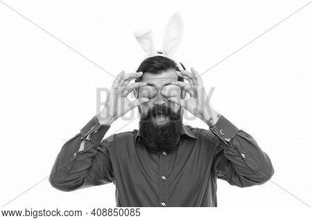 Mr Bunny Hop. Hipster Hold Eggs As Glasses. Easter Bunny Bringing Eggs. Bearded Man Wear Bunny Ears.