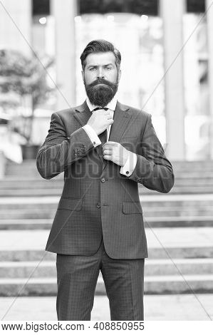 Boutique To You. Confident And Handsome. Serious Bride Groom Fixing Tie Outdoor. Brutal Male Beauty.