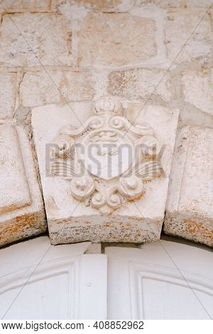 Close-up Of A Convex Architectural Relief Depicting Symbols.