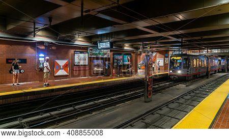San Francisco, California, Usa - August 2019: Muni Subway Train Arriving At Castro Station While Com