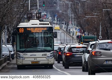 Bucharest, Romania - February 05, 2021: Bucharest Transport Society Trolleybuses And Buses Are In Tr