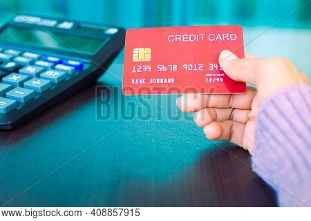 Hand Holding Credit Card With Calculator. Shopping Online. Planing Earn Money Investment And Saving