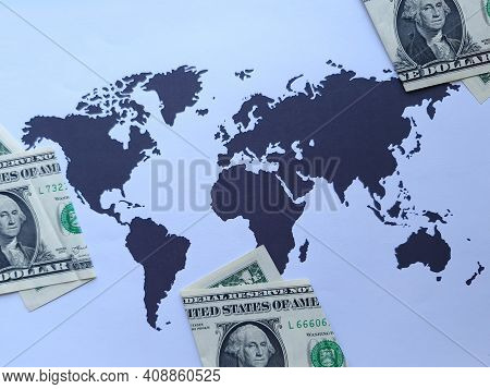 American One Dollar Bills And Background With A World Map In Black And White