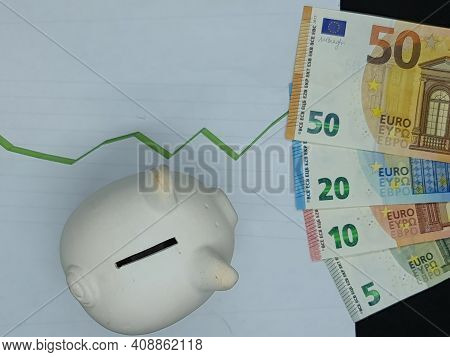 European Banknotes And Piggy Bank On Background With Rising Trend Green Line, View From Above