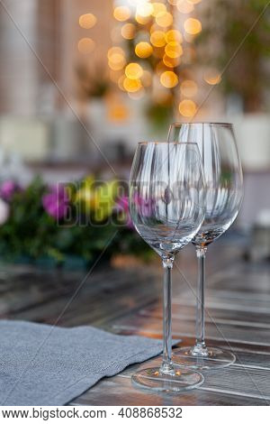 Modern Veranda Restaurant Interior, Flowers, Banquet Setting, Glasses, Plates