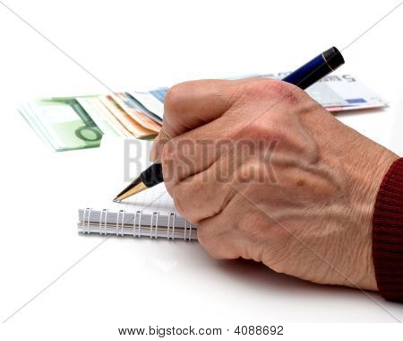 Hand, Pen, Notebook And Money