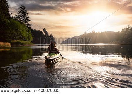 Adventurous Girl Kayaking In The Pacific Ocean. Sunset Sky Art Render. Taken In San Josef Bay, Cape