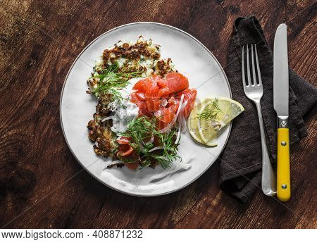 Cabbage Fritters With Smoked Salmon And Greek Yogurt Sauce On A Wooden Background, Top View. Delicio