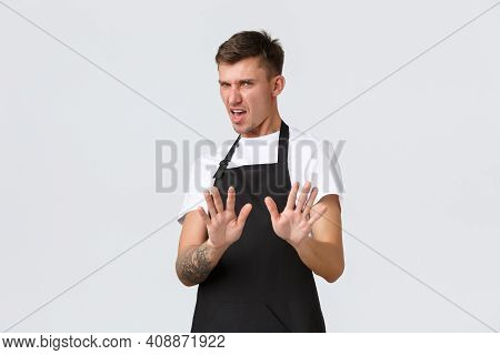 Employees, Grocery Stores And Coffee Shop Concept. Displeased And Reluctant Picky Guy Step Back And