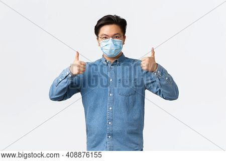 Covid-19, Preventing Virus, And Social Distancing At Workplace Concept. Confident Asian Man In Shirt